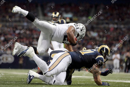 Maurice Jones-Drew, Chris Long. Oakland Raiders running back Maurice Jones-Drew, top, flips over St. Louis Rams defensive end Chris Long during the second quarter of an NFL football game, in St. Louis