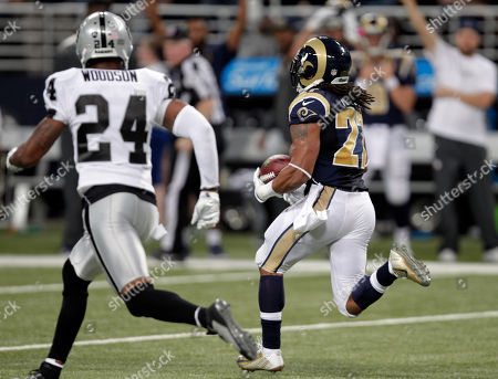 Stock Picture of Tre Mason, Charles Woodson. St. Louis Rams running back Tre Mason, right, runs for an 89-yard touchdown as Oakland Raiders free safety Charles Woodson, left, gives chase during the second quarter of an NFL football game, in St. Louis