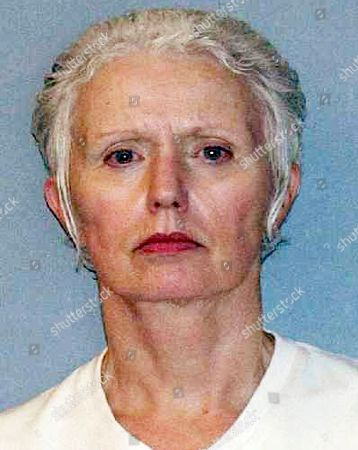 FILE - This file June 23, 2011, booking photo provided by the U.S. Marshals Service shows Catherine Greig, longtime girlfriend of Whitey Bulger who was captured with Bulger. She was sentenced to prison in 2012 for harboring a fugitive and other crimes. The U.S. Marshals Service will auction items belonging to Bulger and Greig on . The proceeds will be divided among the families of Bulger's victims