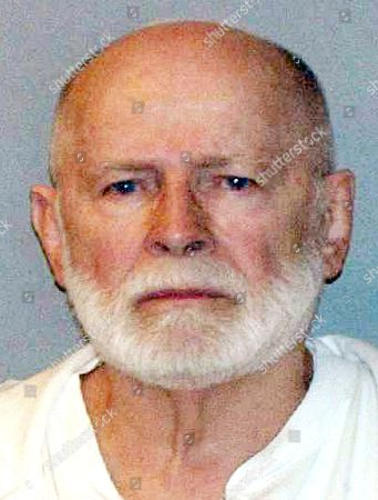 "FILE - This file June 23, 2011, booking photo provided by the U.S. Marshals Service shows James ""Whitey"" Bulger. He was convicted in Boston federal court in August 2013 of multiple murders and other crimes. The U.S. Marshals Service will auction items belonging to Bulger and his girlfriend Catherine Greig on . The proceeds will be divided among the families of Bulger's victims"