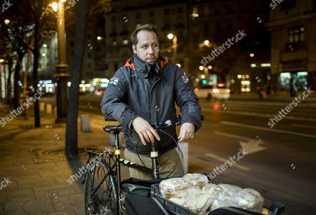 Founder of the Budapest Bike Maffia local volunteer organization Zoltan Havasi prepares to distribute sandwiches to homeless people in central Budapest, Hungary, 11 December 2017 (issued on 12 December 2017). The NGO accept money or food donations from the public to enable the volunteers to deliver food by bicycle to people in need.