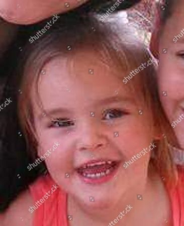 This photo provided by Knoxville Police Department shows Brooklynne Emerie Enix. The Tennessee Bureau of Investigation issued an Amber Alert on for Brooklynne Emerie Enix, who they think is with her father Tyler Ward Enix. Police issued a warrant charging Tyler Ward Enix with murder of the girl's mother Kimberly Enix