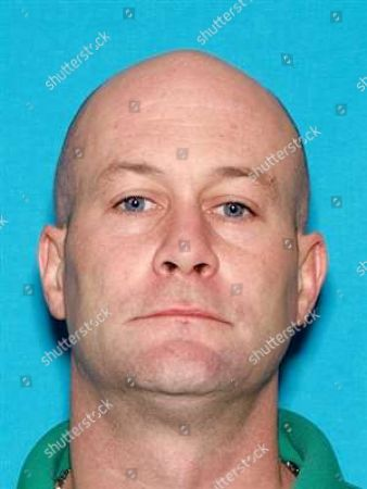 This photo provided by Knoxville Police Department shows Tyler Ward Enix. The Tennessee Bureau of Investigation issued an Amber Alert on for Brooklynne Emerie Enix, who they think is with her father Tyler. Police issued a warrant charging Tyler Ward Enix with murder of the girl's mother Kimberly Enix
