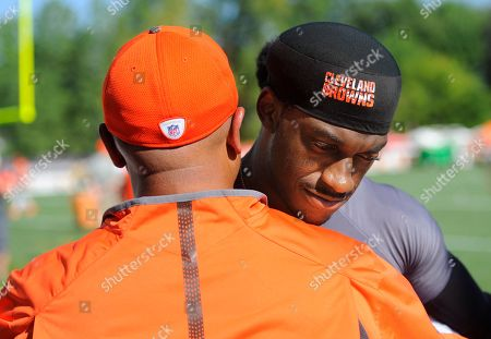 Robert Griffin III, Hugh Jackson. Cleveland Browns quarterback Robert Griffin III hugs head coach Hue Jackson after practice at the NFL football team's training camp, in Berea, Ohio