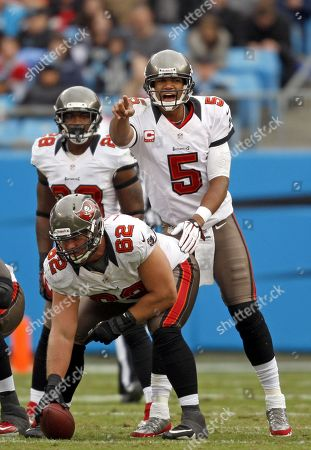 Josh Freeman, Ted Larsen. Tampa Bay Buccaneers quarterback Josh Freeman (5) directs his team as he awaits the snap from center Ted Larsen (62) as the play the Tampa Bay Buccaneers in an NFL football game in Charlotte, N.C