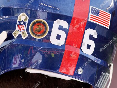 New York Giants tackle David Diehl wears military sticke rs on his helmet in the second half of an NFL football game against the Cincinnati Bengals, in Cincinnati