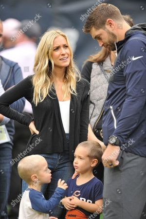 Chicago Bears quarterback Jay Cutler (6) talks with his wife Kristin Cavallari and his sons Jaxon Wyatt, left, Camden Jack Cutler before an NFL football game against the Jacksonville Jaguars in Chicago