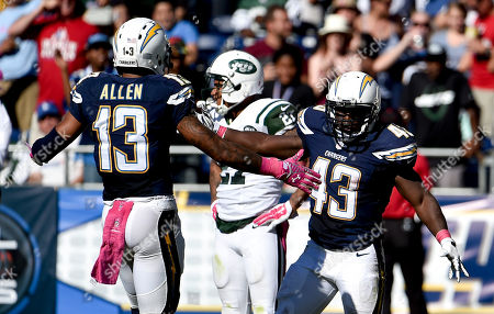 San Diego Chargers quarterback Philip Rivers, left, greets running back Branden Oliver after a long run against the New York Jets during the second half of an NFL football game, in San Diego