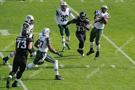Bart Scott, Greg B. Jones. New York Jets inside linebacker Bart Scott, left, intercepts a pass in front of Jacksonville Jaguars fullback Greg B. Jones (33) during the first half of an NFL football game, in Jacksonville, Fla