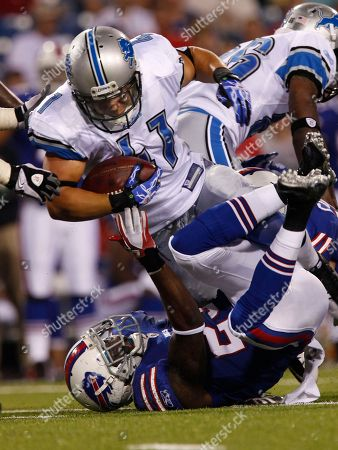 Ian Johnson, Aaron Williams. Detroit Lions' Ian Johnson (41) is tackled by Buffalo Bills' Aaron Williams (23) during the third quarter of an NFL preseason football game in Orchard Park, N.Y