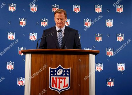 NFL Commissioner Roger Goodell pauses as he speaks during a news conference, in New York. Goodell says the NFL wants to implement new personal conduct policies by the Super Bowl. The league has faced increasing criticism that it has not acted quickly or emphatically enough concerning the domestic abuse cases. The commissioner reiterated that he botched the handling of the Ray Rice case