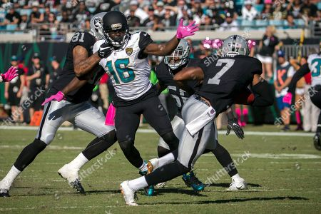 Jacksonville Jaguars running back Denard Robinson (16) chases Oakland Raiders punter Marquette King (7) after he picked up a botched punt and runs for a first down during the fourth quarter of an NFL football game, in Jacksonville, Fla. The Raiders beat the Jaguars 33-16