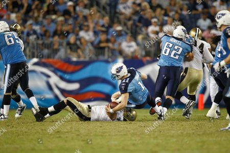 Chris Simms, Jeff Charleston. Tennessee Titans quarterback Chris Simms (11) is sacked by New Orleans Saints defensive end Jeff Charleston (97) during an NFL preseason football game at LP Field in Nashville, Tenn