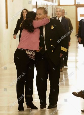 San Francisco Fire Chief Joanne Hayes-White, right, hugs an unidentified woman at City Hall in San Francisco, . Mayor Ed Lee, who oversaw a technology-driven economic boom in San Francisco that brought with it sky-high housing prices despite his commitment to economic equality, died suddenly early Tuesday at age 65
