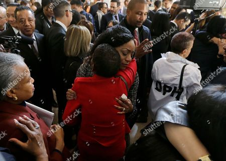 Supervisor Malia Cohen, center, hugs supporters after a news conference at City Hall in San Francisco, . Mayor Ed Lee, who oversaw a technology-driven economic boom in San Francisco that brought with it sky-high housing prices despite his commitment to economic equality, died suddenly early Tuesday at age 65