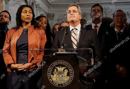 City Attorney Dennis Herrera, center, speaks at a news conference next to acting mayor London Breed, left, at City Hall in San Francisco, . Mayor Ed Lee, who oversaw a technology-driven economic boom in San Francisco that brought with it sky-high housing prices despite his commitment to economic equality, died suddenly early Tuesday at age 65