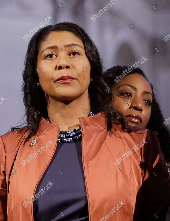 San Francisco Board of Supervisors President and acting mayor London Breed, left, stands in front of Supervisor Malia Cohen at a news conference at City Hall in San Francisco, . Mayor Ed Lee, who oversaw a technology-driven economic boom in San Francisco that brought with it sky-high housing prices despite his commitment to economic equality, died suddenly early Tuesday at age 65