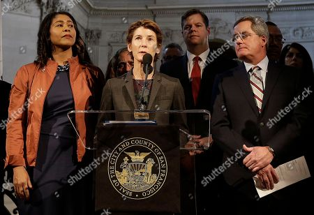 Dr. Susan Ehrlich, CEO at Zuckerberg San Francisco General Hospital and Trauma Center, center, speaks at a news conference next to acting mayor London Breed, left, and City Attorney Dennis Herrera, right, at City Hall in San Francisco, . Mayor Ed Lee, who oversaw a technology-driven economic boom in San Francisco that brought with it sky-high housing prices despite his commitment to economic equality, died suddenly early Tuesday at age 65