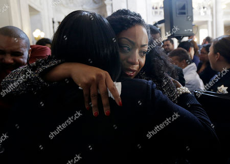 Supervisor Malia Cohen, facing, cries as she hugs a supporter after a news conference at City Hall in San Francisco, . Mayor Ed Lee, who oversaw a technology-driven economic boom in San Francisco that brought with it sky-high housing prices despite his commitment to economic equality, died suddenly early Tuesday at age 65