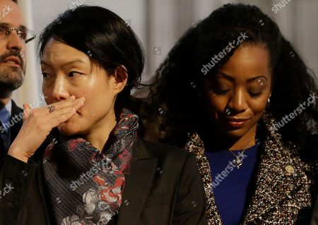 Supervisors Jane Kim, left, and Malia Cohen stand at a news conference at City Hall in San Francisco, . Mayor Ed Lee, who oversaw a technology-driven economic boom in San Francisco that brought with it sky-high housing prices despite his commitment to economic equality, died suddenly early Tuesday at age 65