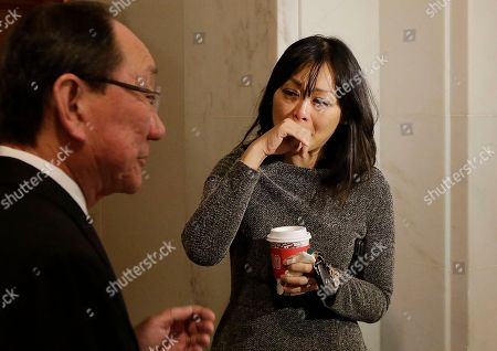 Assessor-Recorder Carmen Chu, right, cries while interviewed before a news conference at City Hall in San Francisco, . Mayor Ed Lee, who oversaw a technology-driven economic boom in San Francisco that brought with it sky-high housing prices despite his commitment to economic equality, died suddenly early Tuesday at age 65