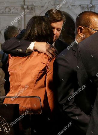San Francisco Board of Supervisors President and acting mayor London Breed, left, hugs Supervisor Mark Farrell after a news conference at City Hall in San Francisco, . Mayor Ed Lee, who oversaw a technology-driven economic boom in San Francisco that brought with it sky-high housing prices despite his commitment to economic equality, died suddenly early Tuesday at age 65