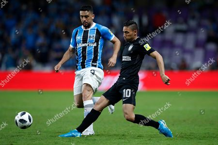 Jonathan Urretaviscaya, Gremio Edilso. Mexico's Pachuca Jonathan Urretaviscaya, right, passes the ball as Brazil's Gremio Edilson tries to stop him during the Club World Cup semifinal soccer match between Gremio and Pachuca at the Hazza Bin Zayed stadium in Al Ain, United Arab Emirates