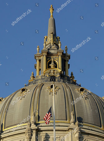 A flag flies at half-staff on the mayor's balcony at City Hall for Mayor Ed Lee in San Francisco, . Mayor Ed Lee, who oversaw a technology-driven economic boom in San Francisco that brought with it sky-high housing prices despite his commitment to economic equality, died suddenly early Tuesday at age 65