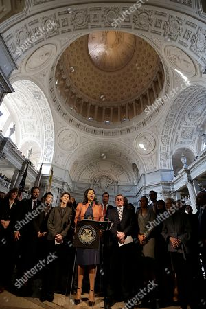 San Francisco Board of Supervisors President and acting mayor London Breed, center, speaks at a news conference at City Hall in San Francisco, . Mayor Ed Lee, who oversaw a technology-driven economic boom in San Francisco that brought with it sky-high housing prices despite his commitment to economic equality, died suddenly early Tuesday at age 65