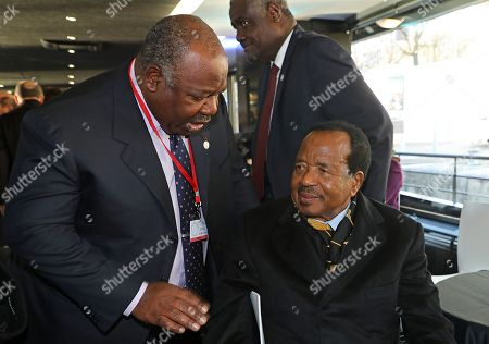 Gabonese President Ali Bongo Ondimba (L) speaks with Cameroon's President Paul Biya on the boat which carries heads of state to the One Planet Summit  at La Seine Musicale venue on the Ile Seguin in Boulogne-Billancourt, near Paris, France, 12 December 2017. The French President hosts 50 world leaders for the One Planet Summit, hoping to jump-start the transition to a greener economy two years after the historic Paris agreement to limit climate change.