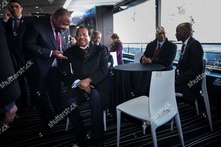 "Gabonese President Ali Bongo Ondimba (L) speaks with Cameroon's President Paul Biya talk on the ""Mirage"" boat which carries heads of state to the One Planet Summit"