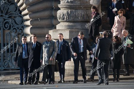 French President Emmanuel Macron and King Mohammed VI of Morocco walk to the 'Mirage' boat with other heads of state on their way to the Ileana Cabra Seguin near Paris during the One Planet Summit in Paris