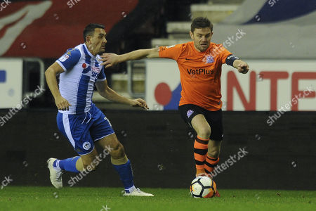 Sam Finley of AFC Fylde gets away from Alex Bruce of Wigan Athletic during Wigan Athletic vs AFC Fylde, Emirates FA Cup Football at the DW Stadium on 12th December 2017