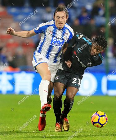 Stock Picture of Michy Batshuayi of Chelsea and Dean Whitehead of Huddersfield Town