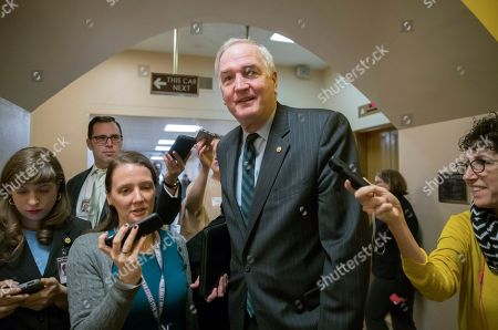 Reporters seek a comment from Sen. Luther Strange, R-Ala., about Republican Roy Moore who is running for the Senate in a special election, on Capitol Hill in Washington, . Sen. Strange currently holds the seat vacated by former Sen. Jeff Sessions, R-Ala., who became the President Donald Trump's attorney general