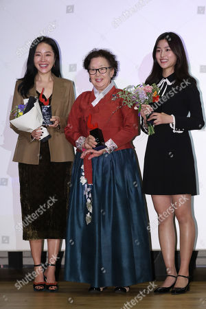 Winners of 2017 Women in Film awards pose for photos at a ceremony in Seoul, South Korea, 12  December  2017.  Actresses Uhm Ji-won (from L to R), Na Moon-hee and Lee Soo-kyung are some of the winners of the awards that recognize women in the film industry in nine categories.