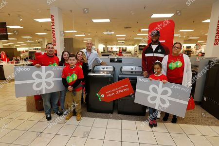 Buccaneers player O.J. Howard reveals a surprise giveaway of a $5,000 shopping spree and GE washer and dryer to families affected by Hurricane Irma at the Westshore JCPenney, in Tampa, Fla