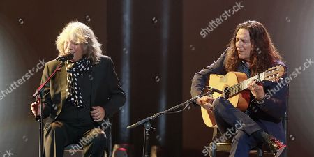 Flamenco singer Jose Merce (L) and singer 'Tomatito' perform on stage during the Ondas awards gala held at the Exhibitions and Congresses Palace in Seville, southern Spain, 12 December 2017.