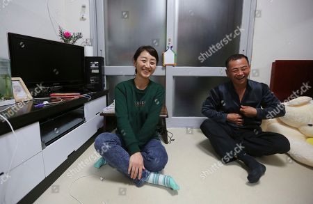 Stock Picture of Kim Sun-hee, Chang Kil-dong. North Korean female defector Kim Sun-hee, 38, and her Korean-Chinese husband Chang Kil-dong, 48, smile during an interview at their house in Gunpo, South Korea. Kim, who came to South Korea in 2008, lives in a small apartment near Seoul with her Korean-Chinese husband, Chang who bought her for 8,000 yuan ($1,200) when she was 18