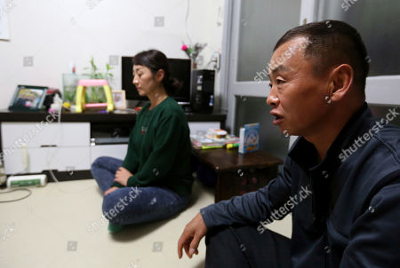 Kim Sun-hee, Chang Kil-dong. North Korean female defector Kim Sun-hee, 38, listens to the speak of her Korean-Chinese husband Chang Kil-dong, 48, during an interview at their house in Gunpo, South Korea. Kim, who came to South Korea in 2008, lives in a small apartment near Seoul with her Korean-Chinese husband, Chang who bought her for 8,000 yuan ($1,200) when she was 18