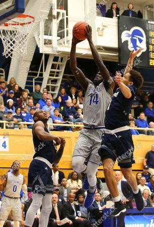 Ismael Sanogo, Davauhnte Turner, Nick Griffin. Seton Hall's Ismael Sanogo (14) goes up for a dunk against St. Peter's Nick Griffin, left, and Davauhnte Turner, right, during the second half of an NCAA college basketball game in South Orange, N.J