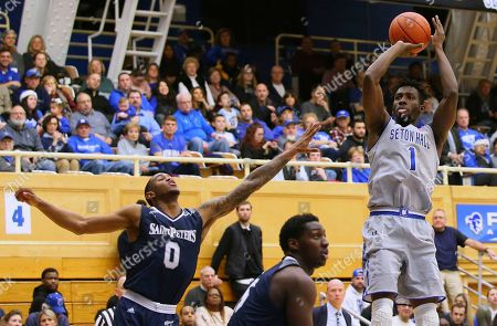 Michael Nzei, Nick Griffin. Seton Hall's Michael Nzei (1) takes a shot against St. Peter's Nick Griffin (0) during the second half of an NCAA college basketball game in South Orange, N.J