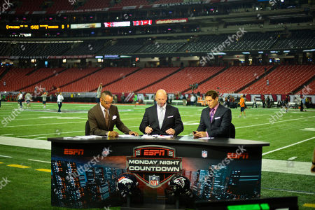ESPN anchors Stuart Scott, Trent Dilfer and Steve Young, from left, speak before the first half of an NFL football game, between the Denver Broncos and Atlanta Falcons, in Atlanta