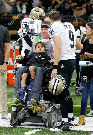 New Orleans Saints quarterback Drew Brees (9) greets former New Orleans Saints player Steve Gleason, before an NFL football game against the Atlanta Falcons in New Orleans