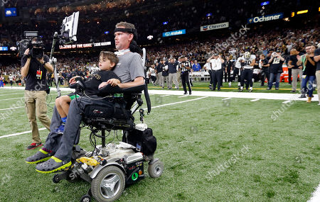 Steve Gleason, Rivers Gleason. Former New Orleans Saints player Steve Gleason rides onto the field with with his son Rivers before an NFL football game against the Atlanta Falcons in New Orleans