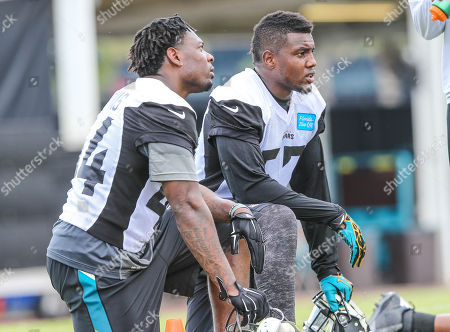 Linebacker Todd Thomas (44), left, and linebacker Thurston Armbrister (57)during drills at the Jacksonville Jaguars NFL football rookie camp, in Jacksonville, Fla