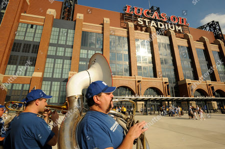 "Chris McMillan, Indianapolis, plays sousaphone with the ""12th Man Brass Band' outside Lucas Oil Stadium before a preseason NFL football game between the Minnesota Vikings and the Indianapolis Colts in Indianapolis"