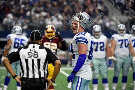 Jason Witten, Greg Bradley. Dallas Cowboys' Jason Witten (82) talks with head linesman Greg Bradley (98) during a video review of a touchdown scored by Witten in the first half of an NFL football game against the Washington Redskins, in Arlington, Texas