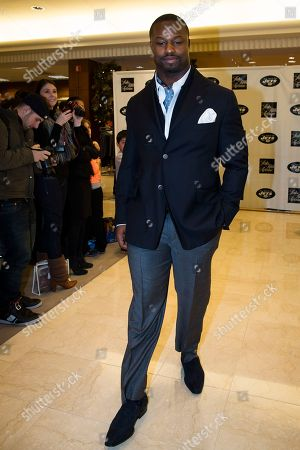 The New York Jets' Bart Scott models an outfit during a charity fashion show, in Short Hills, N.J. Saks Fifth Avenue and the New York Jets have partnered for the event where a portion of the evening's sales will be donated to the Jets Foundation