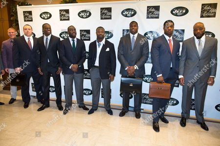Nick Folk, Mike DeVito, Stephen Hill, Demario Davis, Bart Scott, D'Brickashaw Ferguson, Quinton Coples, Calvin Pace. Left to right) The New York Jets' Nick Folk, Mike DeVito, Stephen Hill, Demario Davis, Bart Scott, D'Brickashaw Ferguson, Quinton Coples, and Calvin Pace pose for a photograph during a charity fashion show, in Short Hills, N.J. Saks Fifth Avenue and the New York Jets have partnered for the event where a portion of the evening's sales will be donated to the Jets Foundation